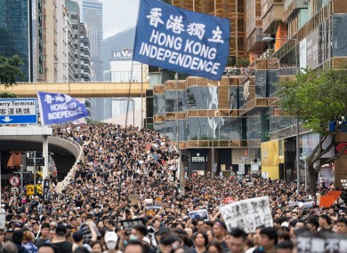 Protesters carry a Hong Kong independence flag during the anti government march on Sunday