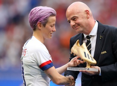 Megan Rapinoe and Gianni Infantino.