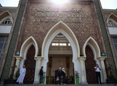 People stand outside the Moroccan court during the trial of the men accused of killing two Scandinavian tourists.