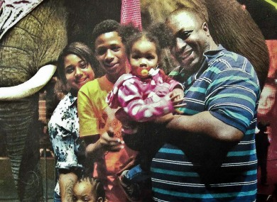 Eric Garner, right, poses with his children  (file photo)
