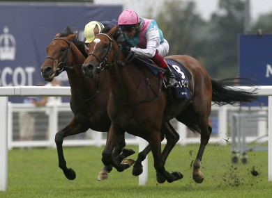 Enable and Frankie Dettori (right) get the better of Crystal Ocean and James Doyle to win The King George VI.