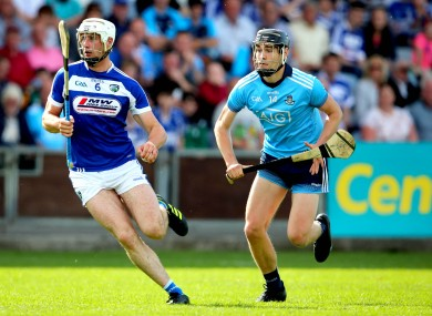 Dublin's Ronan Hayes chases down Ryan Mullaney of Laois.
