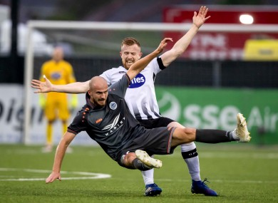 Dundalk's Sean Hoare with Roman Debelko of Riga FC.