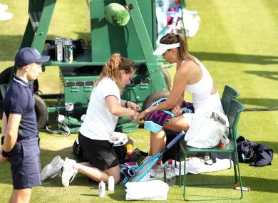 Sharapova receives treatment before retiring.