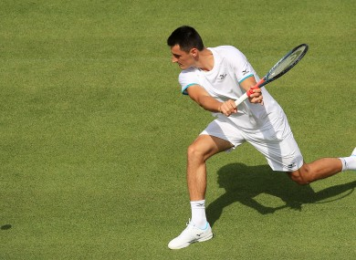 Tomic in action at Wimbledon on Tuesday.