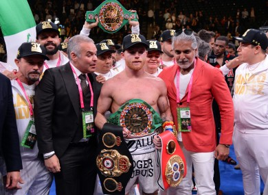 Canelo celebrates his unification victory over Danny Jacobs.