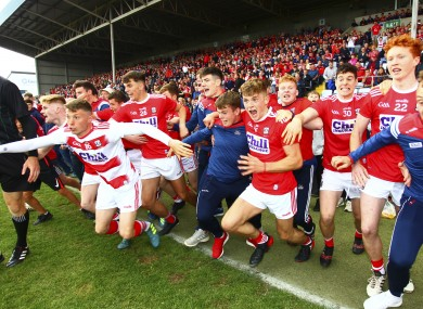 Cork players react to the final whistle at O'Moore Park.