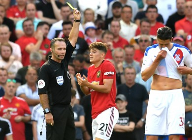Daniel James is booked for simulation against Crystal Palace.