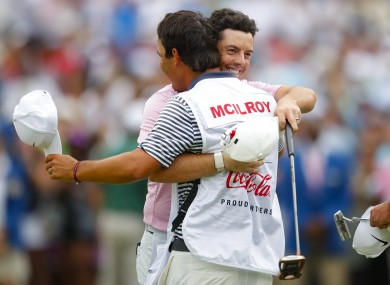 McIlroy celebrates with his caddie Harry Diamond.
