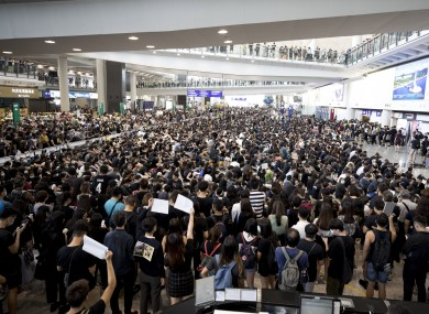 Crowds descend on Hong Kong International Airport.