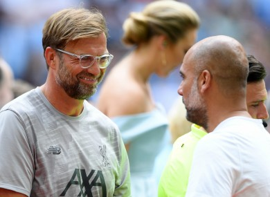 Jurgen Klopp (L) with Pep Guardiola