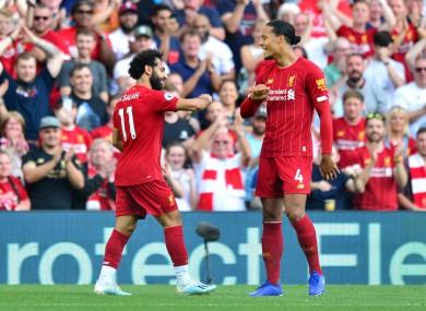 Salah celebrates his second goal with Virgil van Dijk.