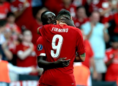 Sadio Mane and Roberto Firmino celebrate.