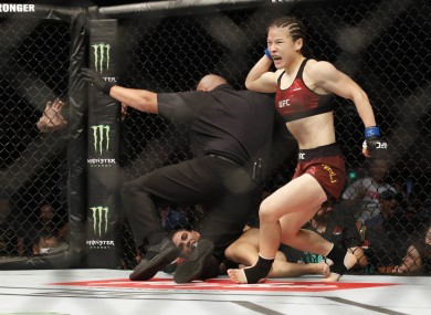 Zhang Weili (blue gloves) defeats Jessica Andrade (red gloves) during UFC Fight Night at Shenzhen Universiade Sports Centre.
