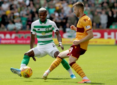 Motherwell's Liam Polworth and Celtic's Boli Bolingoli battle for the ball.
