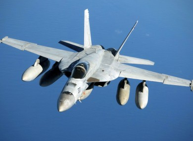 Navy F/A-18 Super Hornet in flight after refueling over the Pacific Ocean near the coast of Brisbane, Australia.