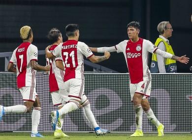 Edson Alvarez celebrates scoring with team-mates.