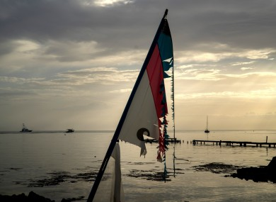 A surf sail shattered by the wind is seen in a private harbor while several ships leave the harbor to protect themselves from the arrival of Hurricane Dorian In Boqueron, Puerto Rico.