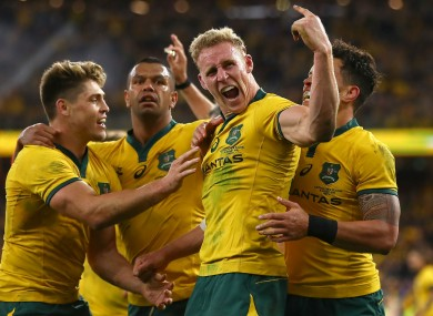 Reece Hodge celebrates his try for the Wallabies.