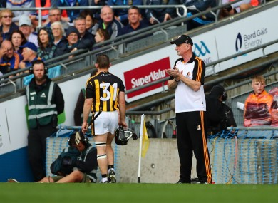 Richie Hogan walks past Brian Cody after being red carded.