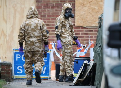 Members of the military wear protective clothing as work continues on the home of former Russian spy Sergei Skripal in Salisbury, Wiltshire.