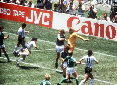 Brown scoring a header against Germany in the '86 World Cup final.