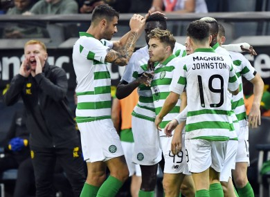 Celtic players celebrate James Forrest's opening goal.