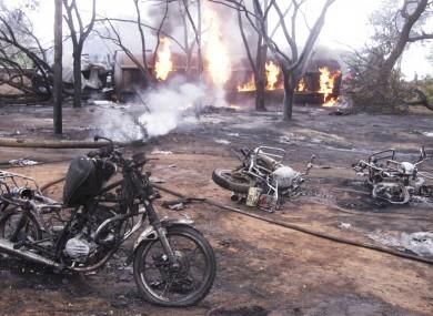 Destroyed motorbikes and debris litter the scene in Morogoro