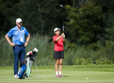 12-year-old Canadian Michelle Liu lines up an approach shot (file pic).
