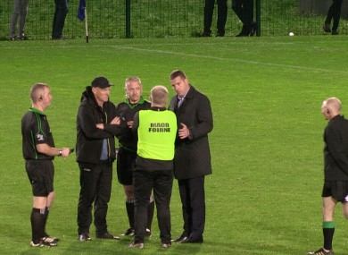 Ciaran McCavana calls a halt to a shoot-out after consulting both managers.