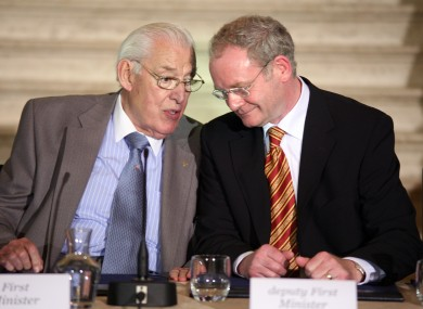Former Northern Ireland Deputy First Minister Martin McGuinness (R) and First Minister Ian Paisley (L)