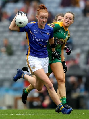 Aishling Moloney is tackled by Sarah Wall.