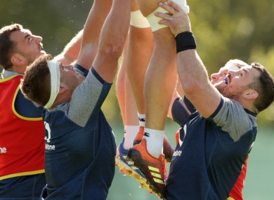 CJ Stander and Cian Healy lifting a line-out in training.