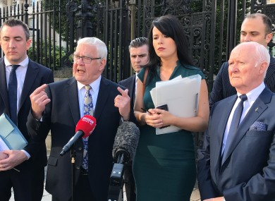 Francis McGuigan (second left) has welcomed the ruling by the Court of Appeal in Belfast