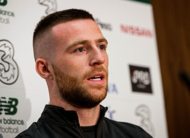 Jack Byrne pictured speaking at a pre-match press conference.