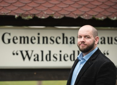 Stefan Jagsch (NPD), local leader of Altenstadt-Waldsiedlung, stands in front of the community house in the district in which he was elected.
