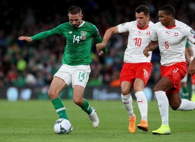 Ireland's Conor Hourihane under pressure from Granit Xhaka and Manuel Akanji of Switzerland.