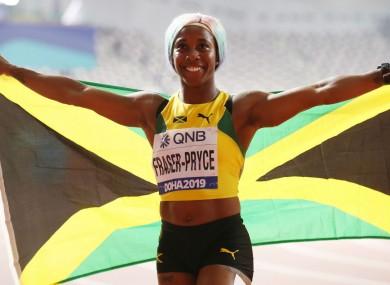 Shelly-Ann Fraser-Pryce celebrates her gold medal