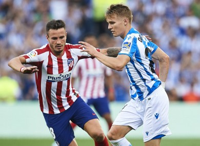 Martin Odegaard takes on Saul Niguez during Real Sociedad's win over Atletico Madrid.