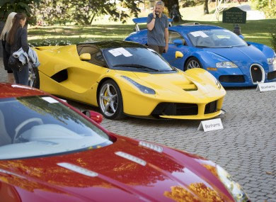 People looking at a Ferrari LaFerrari at the auction