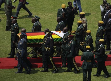 Mugabe's coffin arrives for a state funeral for at the National Sports Stadium in Harare.