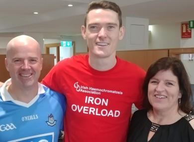 Karl Mackey and his sister Amanda with Gaelic footballer Brian Fenton