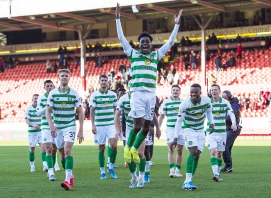 Jeremie Frimpong celebrates with his team-mates in front of the Celtic fans.