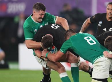 All Blacks player Kieran Read is tackled by Ireland's Jonathan Sexton.