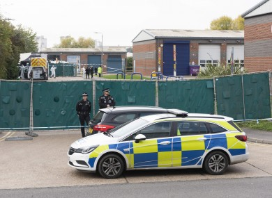 Police officers guard the Waterglade Industrial Park where 39 bodies were found in a lorry container in Grass, Essex.