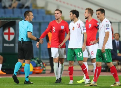 The referee halts play between Bulgaria and England.