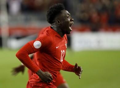 Alphonso Davies celebrates his goal for Canada against USA.