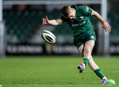 Fitzgerald keeps his head down to drive a kick at goal during the win over Dragons.