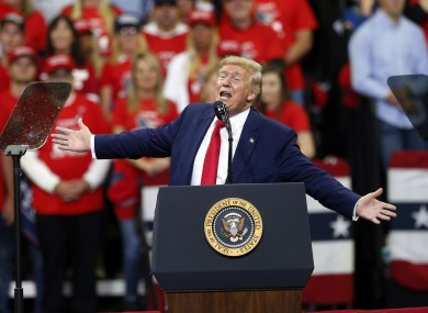 US President Donald Trump at a rally in Minneapolis last night.