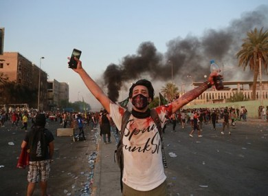 An anti-government protester in Iraq.
